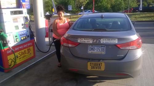 Alexis pumping gas