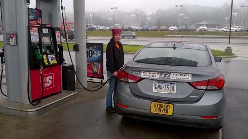 Rebecca pumping gas